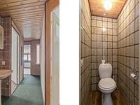 1e Verdieping: <BR>Overloop met tapijt, een wastafel en het tweede toilet.