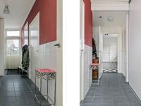 In de bijkeuken met tegelvloer bevind zich een fijne wandkast met daarin de opstelling van de c.v. ketel, de wasmachine aansluiting en een vaatwasser