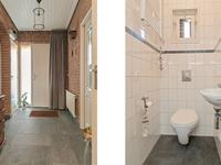 Hal met een mooie donkergrijze tegelvloer, schoonmetselwerk wanden, trap naar de verdieping en een garderobehoekje. Nette volledig betegelde toiletruimte met fonteintje en directe ventilatie. <BR>Vanuit de hal kunt u naar de keuken of rechtstreeks naar de woonkamer.