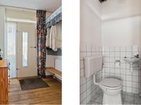Indeling:<BR>U komt binnen in de ruime hal met een houten vloer. Hier bevindt zich ook de meterkast en het deels betegelde toilet.