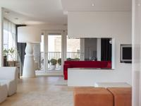 Luxe penthouse met schitterend uitzicht over het IJ aan de Westerdoksdijk te Amsterdam