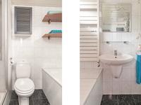 Geheel betegelde badkamer voorzien van 2e toilet, wastafel, douche en ligbad.