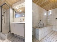 Geheel betegelde badkamer voorzien van wastafel, douche en ligbad. In de badkamer is vloerverwarming gelegd.