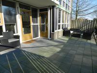 Te huur appartement met 3 slaapkamers en een tuin op de begane grond in de Muziekwijk.